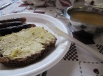 The best meal ever - brown bread, loaded with the best butter ever (Irish butter), sausages, and vegetable soup
